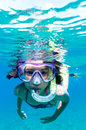 Exploring underwater a little girl with mask in the mediterranean sea Royalty Free Stock Photo