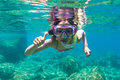 Exploring underwater a little girl with mask in the mediterranean sea Stock Photography