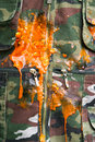Explosion de Paintball sur le camo Photo stock