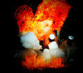 Explosion a flame on drak background Royalty Free Stock Images