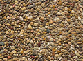 Exposed aggregate concrete with rounded pebbles background texture Stock Image