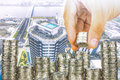 Exposure of Finance and Saving money banking concept,Hope of investor concept,Male hand putting money coin like stack growing busi