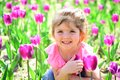 Express positivity. Small child. Natural beauty. Childrens day. Summer girl. Happy childhood. Springtime tulips. weather Royalty Free Stock Photo