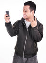 The expression of a man who does not like the phone isolated on white background Stock Images
