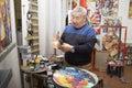 Expressionist artist in his art studio