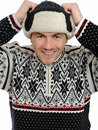 Expressions.Funny winter man in warm hat listening Stock Image