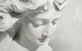 Expressive angel beautiful close up af a face marble sculpture with a sweet expression that looks down Royalty Free Stock Photography