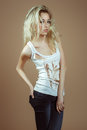 Expressive blonde girl in a white torn top Royalty Free Stock Photo