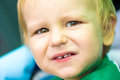 Expressive facial features in a child who looks at photographer Royalty Free Stock Image