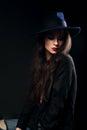 Expressive female makeup model posing in black shirt and elegant Royalty Free Stock Photo