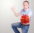 Expressive young man with gift box Royalty Free Stock Photography