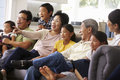 Extended Family Group At Home Watching TV Together Royalty Free Stock Photo