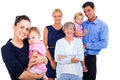 Extended family portrait of young women holding her baby with on background Stock Photo