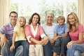 Extended Family Relaxing At Home Together Royalty Free Stock Image