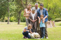 Extended family with their pet dog at park Royalty Free Stock Images