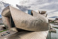 Exterior of the guggenheim museum and iberdrola tower bilbao spain october on october in bilbao spain is a Royalty Free Stock Image