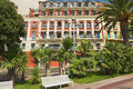 Exterior of the historical building of the Hotel Suisse in Nice, France. Royalty Free Stock Photo
