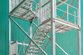 Exterior metal staircase with handrails at a industrial building Royalty Free Stock Photo
