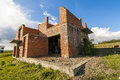 Exterior of an old building under construction. Orange brick wal Royalty Free Stock Photo