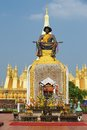 Exterior of the statue of the King Chao Anouvong in front of the Pha That Luang stupa in Vientiane, Laos. Royalty Free Stock Photo