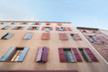 Exterior wall with many windows and shutters, building and architecture Narbonne, France. Royalty Free Stock Photo