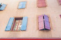 Exterior wall with many windows and shutters, building and archi Royalty Free Stock Photo