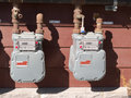 Exterior wall natural gas consumption meters two residential on to measure household energy Stock Photography
