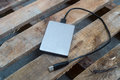 External harddisk on the wood plate Royalty Free Stock Photos