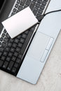 External hdd and laptop over keyboard Stock Image