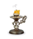 Extinct candle in an old candlestick over white background Royalty Free Stock Images