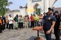 Extinguish the fire people received training to on a burning gas canister in city of solo central java indonesia Stock Photography