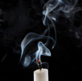 Extinguished candle with smoke Royalty Free Stock Photo
