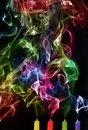Extinguished candles with colorful smoke Royalty Free Stock Photo
