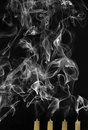 Extinguished candles with smoke Royalty Free Stock Photo