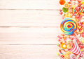 Extra large swirl colored sucker by gummy candy Royalty Free Stock Photo