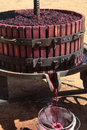 Extracting grape juice with old manual wine press Stock Image