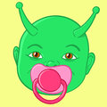 Extraterrestrial green baby head with alien antenna sucking a pink pacifier isolated on a yellow background vector illustration Stock Photo