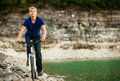 Extreme biking in mountain young man riding his bike on off road terrain Stock Photos
