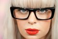 Extreme close up woman retro black plastic glasses Stock Images