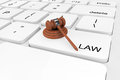 Extreme closeup judge gavel on a keyboard law concept Royalty Free Stock Photo