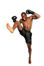 Extreme Fighting Athete kicking Royalty Free Stock Images