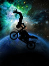 Extreme motorcycle trick motorcyclist executing an on his Royalty Free Stock Photography