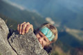 Extreme mountain climb young man finishing his Royalty Free Stock Images