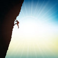 Extreme rock climber silhouette of an against a sunny sky Stock Photography