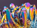 Extreme sharp Titanium rainbow aura quartz crystal cluster stone taken with macro lens stacked from more shots Royalty Free Stock Photo