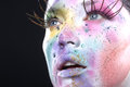 Extreme spattered make up on the face beautiful woman with Stock Photos