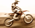 Extreme sport slow motion motorbike pro race driver jumping dirt bike motocross speed challenge concept Stock Image