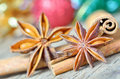 Extremely closeup view of anise star and cinnamon sticks on wooden table Royalty Free Stock Photos