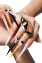 Extremely long nails with nail art and crystal jewellery Stock Photo