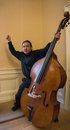 Exuberant excited Asian Musician with his Upright String Bass Royalty Free Stock Photo